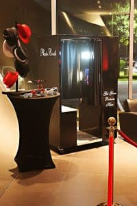 black classic photo booth with black, white and red props