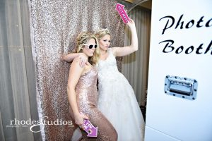 white photo booth with bride and bridesmaid