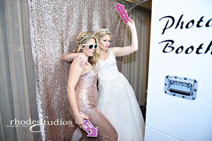 white open air photobooth with rose gold back drop at mission inn wedding bride and guest posing