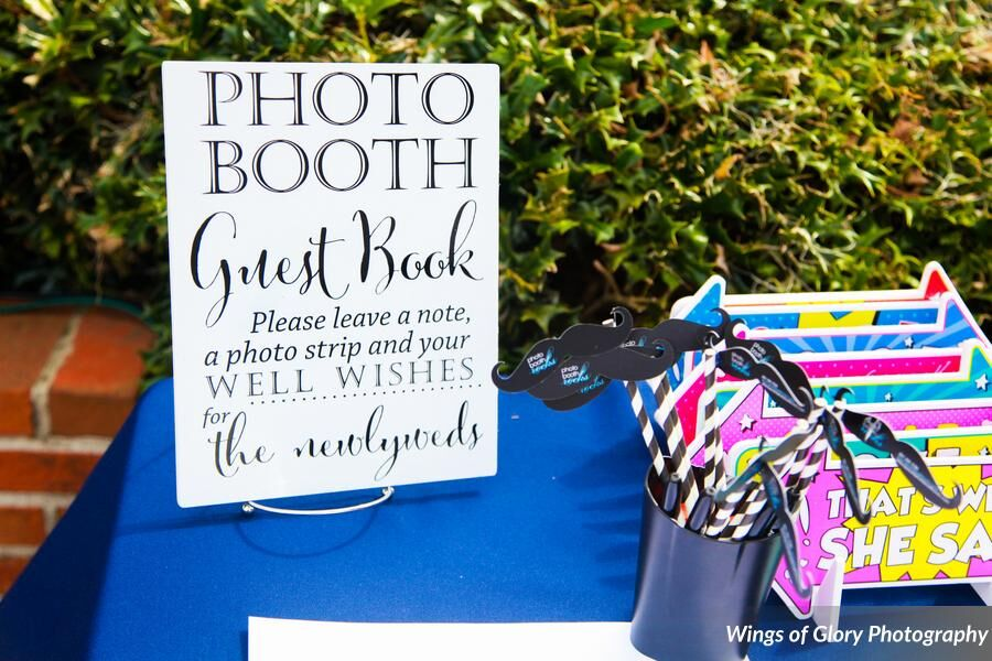 Classic black photo booth at Cypress Grove Estate House wedding props and scrapbook