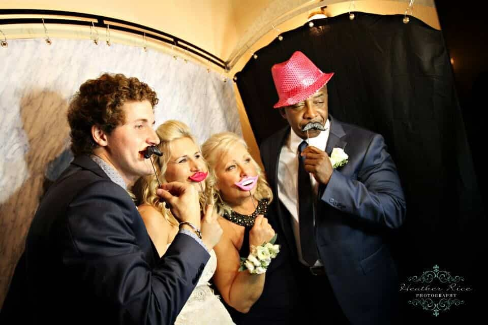 black printz booth style photo booth at casa feliz wedding guests taking silly photos with props