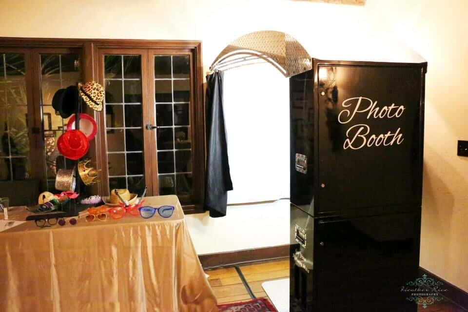 black printz booth style photo booth at casa feliz wedding with props