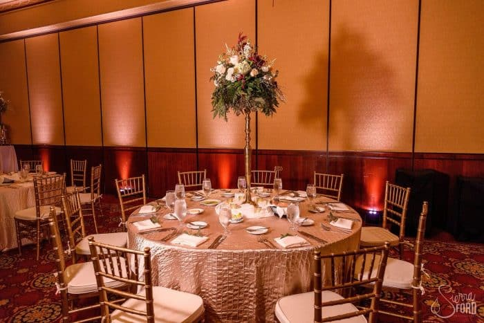 black printz photo booth with gold glitter backdrop at Ballroom at Church Street wedding reception table decor with blush pink uplights