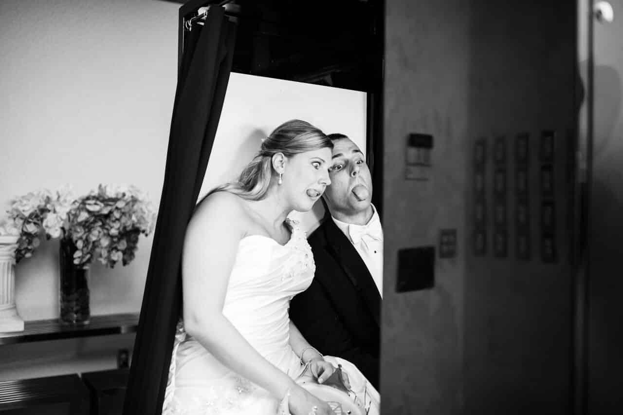 classic black photo booth at timacuan country club wedding with bride and groom