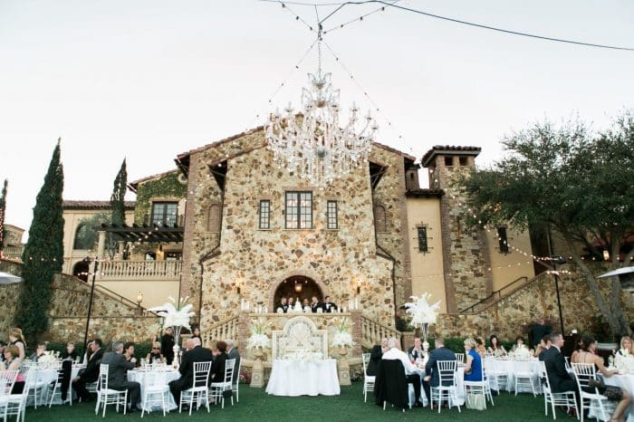 classic black photo booth at Bella Collina wedding reception area with outdoor chandelier