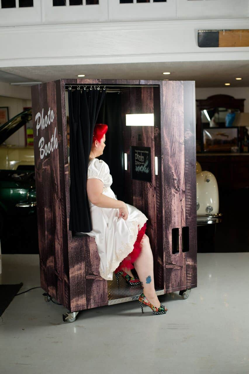 new classic wooden photo booth with bride posing from Photo Booth Rocks at wedding