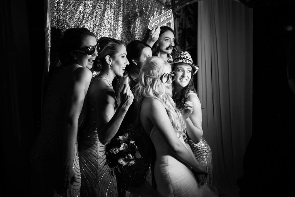 happy bridal party in photo booth